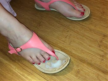 Slipping my pretty feet into my sexy cummy thong sandals.