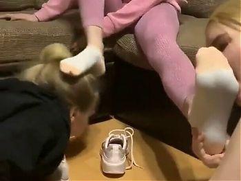 Tow girls licking feet