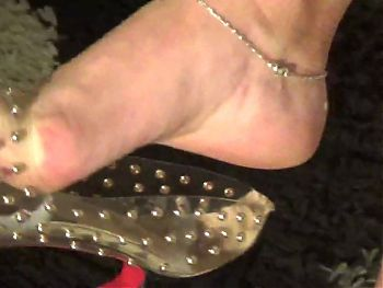 Mature feet tired and sweaty in transparent shoes